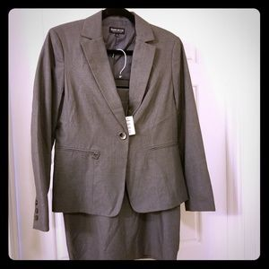 Charcoal gray skirt suit.